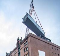 Canal bridge lifted into place over Hamburg warehouses image