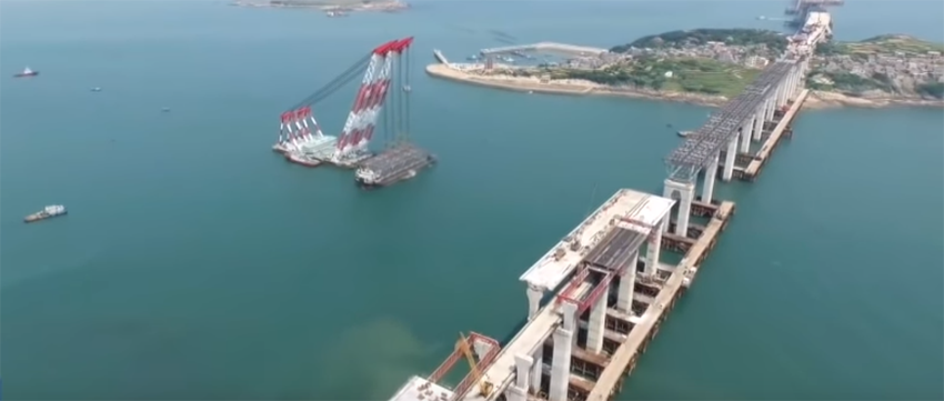 Video showing Pingtan Haixia rail-road bridge closer to completion with 3,400t steel truss girders being lifted into place