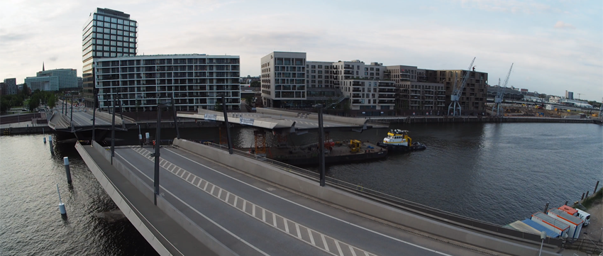 Watch part of Baakenhafen Bridge in Hamburg, Germany removed to allow passage of tall ship image