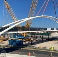Arch bridge lifted into place over Derbyshire road logo